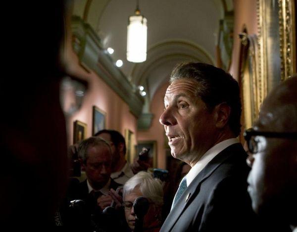 New York Gov. Andrew Cuomo talks to media