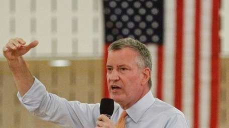 New York City Mayor Bill de Blasio, above