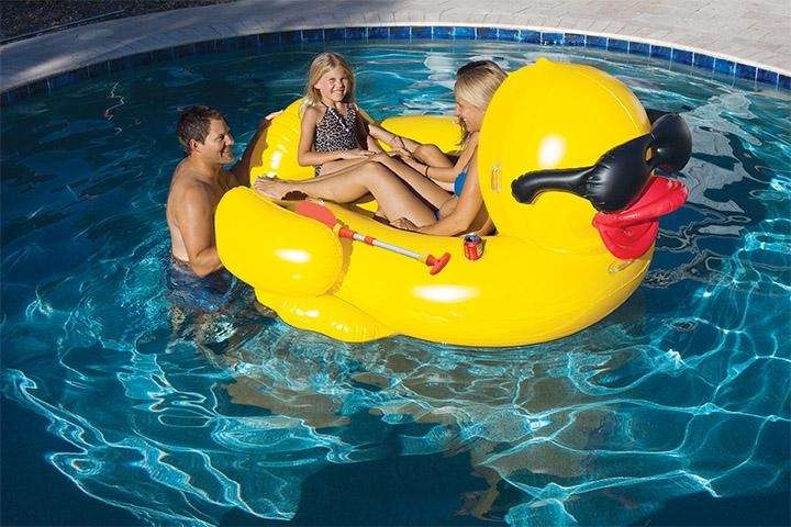 This inflatable ride-on pool float features two handles