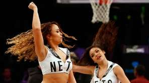 Members of the Brooklynettes perform during a game