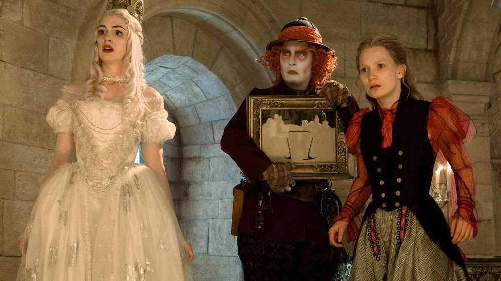 Anne Hathaway, left, is the White Queen, Johnny