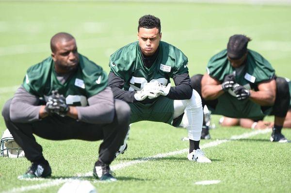 New York Jets cornerback Dexter McDougle stretches during