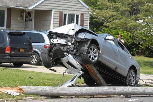 Car is seen propped up on the utility
