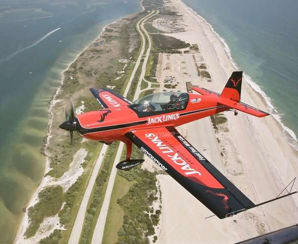 A single-engine Extra 300 L acrobatic plane, with