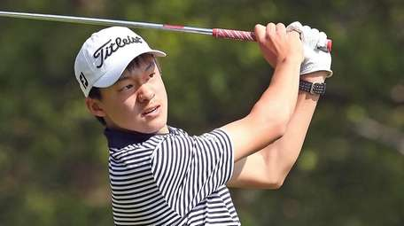 Manhasset's Adam Xiao completes his swing during the