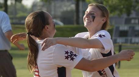 MacArthur's Shannon Myles (left) and pitcher Jessica Budrewicz