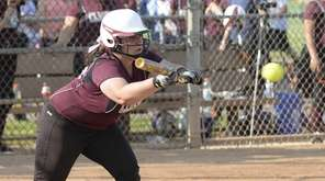 Clarke's Christina Fracchioni (25) looks to bunt in