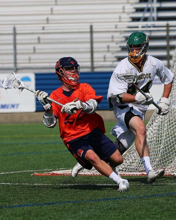 Kevin Mack #22 of Manhasset attacks the net