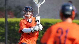 Manhasset goalie Brendan Haggerty #1 clears the ball