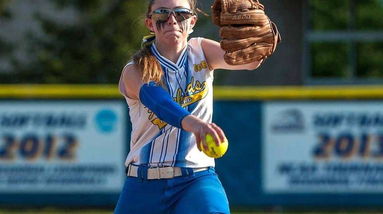 Kellenberg's Kaitlin Geary (14) pitches against Sacred Heart