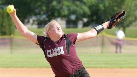 Clarke's Sarah Cornell (14) delivers a strike during