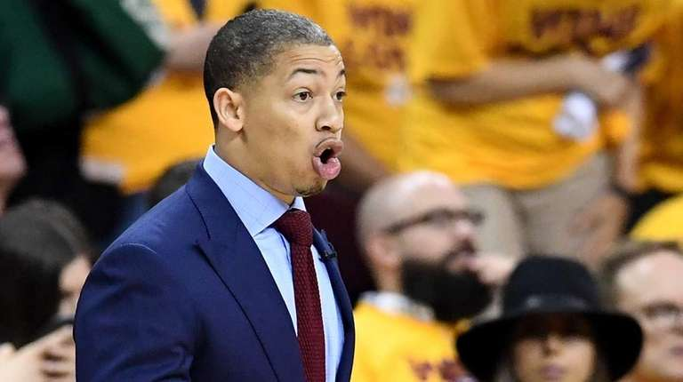 Tyronn Lue of the Cleveland Cavaliers looks on