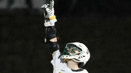 Ward Melville's Chris Grillo (3) points skyward after