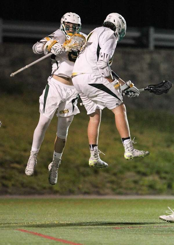 Ward Melville's Eddie Munoz (6) scores and celebrates