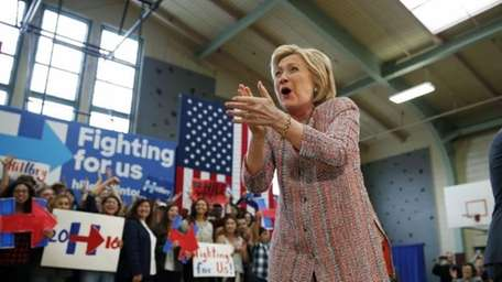 Democratic presidential candidate Hillary Clinton reacts while speaking
