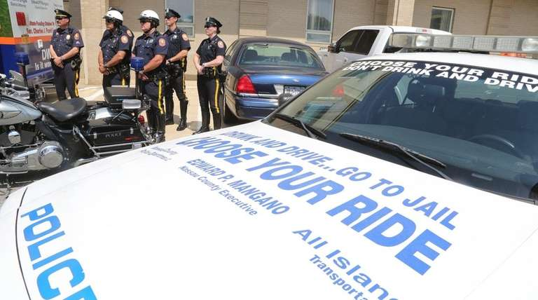 Nassau police officers gather at a news conference