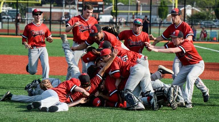Center Moriches celebrates its win over Babylon in