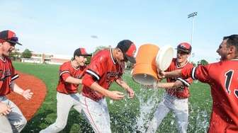 Center Moriches players dump a bucket of water