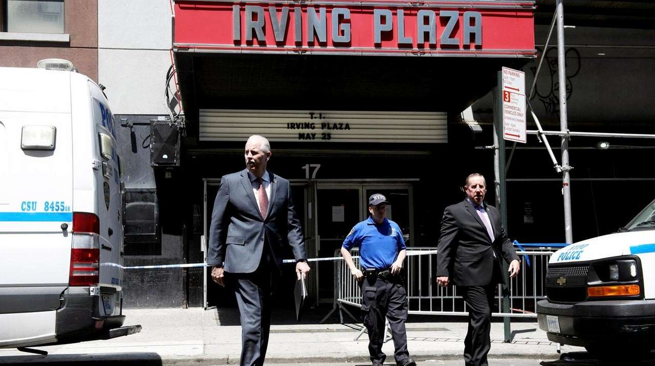 NYPD Chief of Detectives Robert Boyce, left, exits