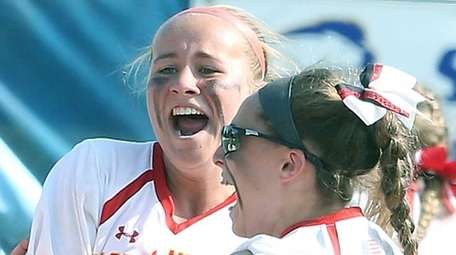 Sacred Heart's Claire O'Brien (center) celebrates after winning