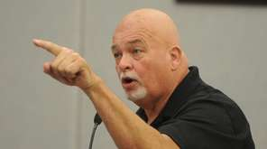 Michael McDermott, of Huntington, vents his frustration to
