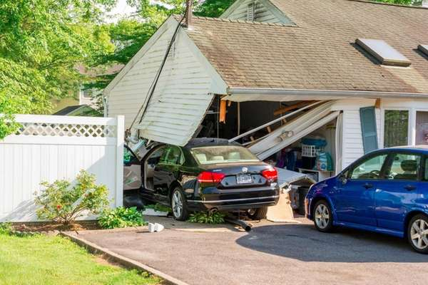 Wrecked car rests in the garage area of
