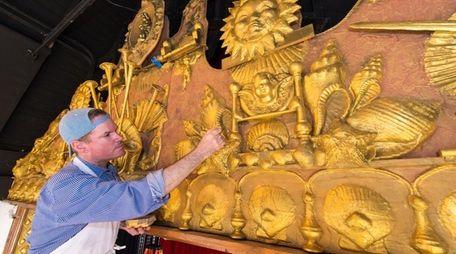 George McGarvey paints the historic proscenium on the
