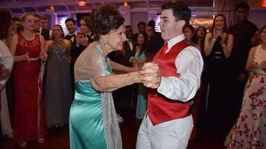 Physics teacher Audrey Hebling dances with student Andrew