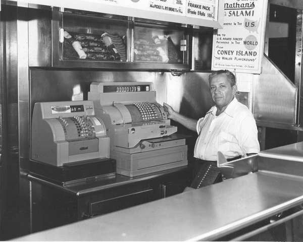 Nathan Handwerker behind the counter of his hot