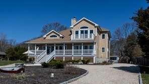 This three-bedroom Postmodern in Southold has a waterfront