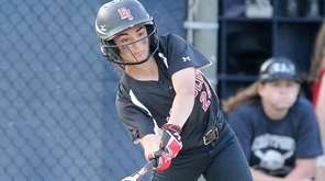 East Islip's Allison Dell'Orto drills an extra-innings hit
