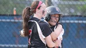 East Islip's Ashley Benvengo (3) and Jackie Carty
