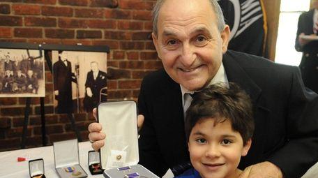 Nicholas Faraone Jr. holds a Purple Heart his