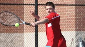 Connetquot's Mikey Josefak hits a backhand during a