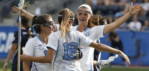 Carly Reed, middle, of North Carolina celebrates her