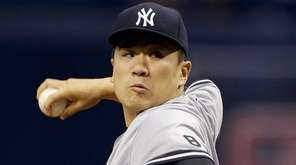 New York Yankees starting pitcher Masahiro Tanaka, pitches