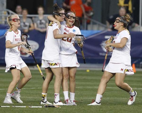 Maryland's Taylor Hensh (20) is congratulated by her