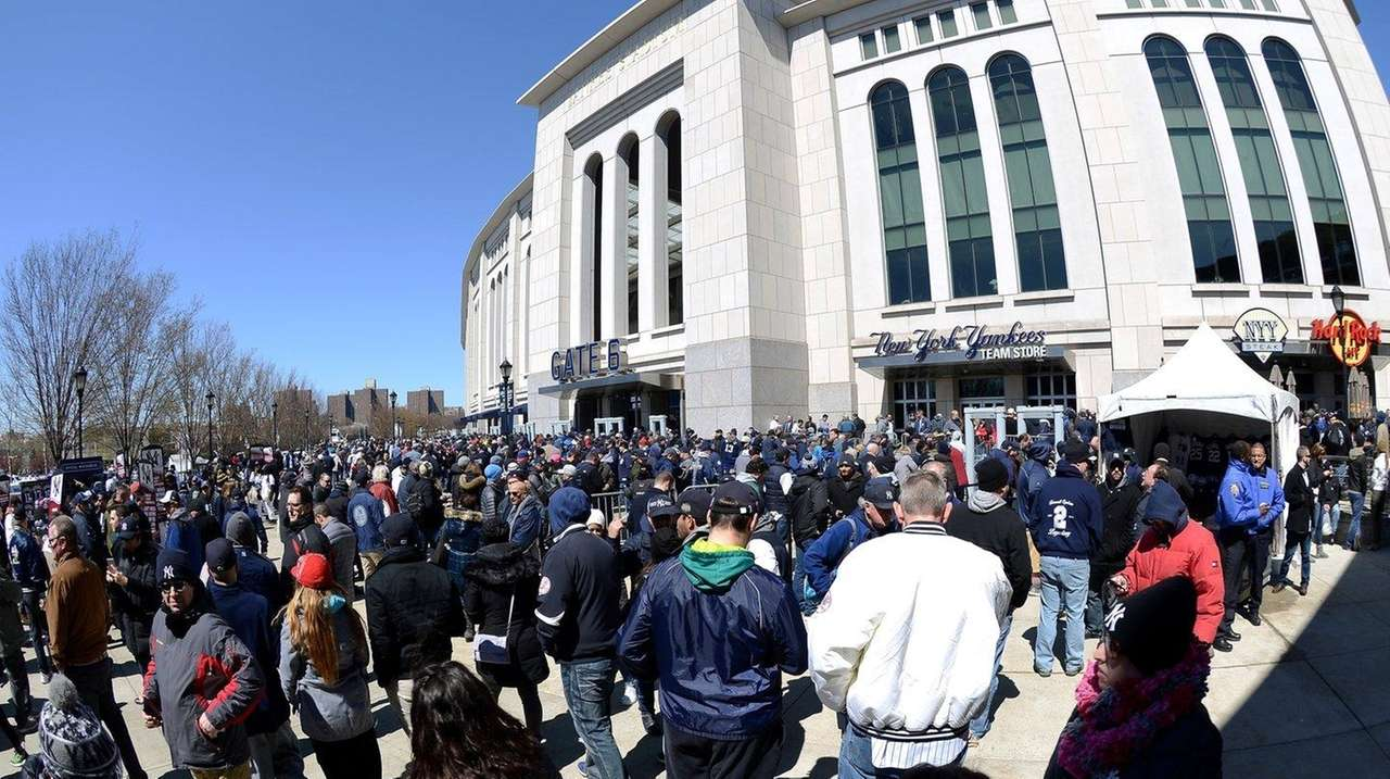 Yankee fans arrive for the opening day game