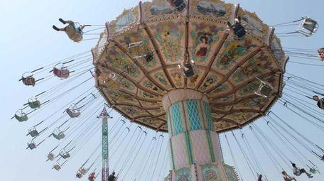 Farmingville's annual fair with rides, food vendors, games,