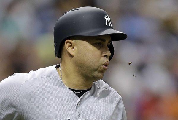 New York Yankees' Carlos Beltran spits sunflower seeds