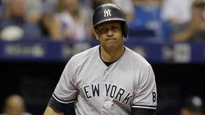 New York Yankees' Alex Rodriguez reacts after striking