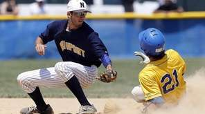 West Islip's Jimmy Matera (21) beats the tag