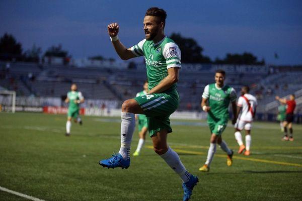 New York Cosmos midfielder Daniel Szetela (14) reacts