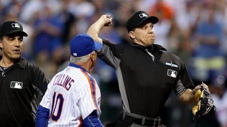 Home plate umpire Adam Hamari throws out Mets