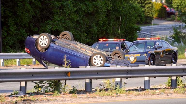 An overturned car closed the eastbound Southern State