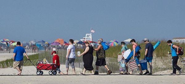 Beachgoers enjoy a warm, sunny day at Jones