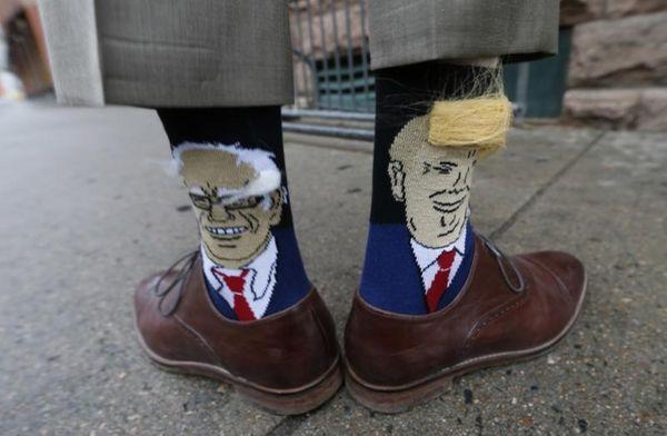 Colorado Gov. John Hickenlooper shows off his socks--one