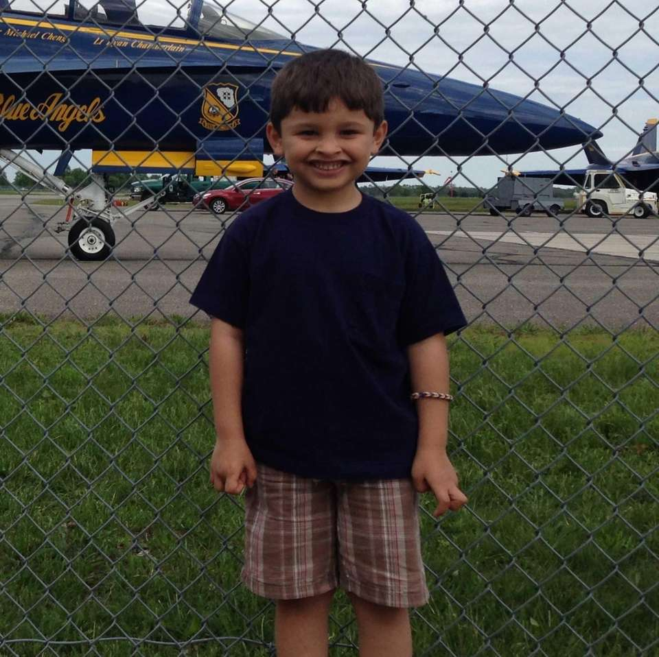 My grandson Jake standing outside the fence at