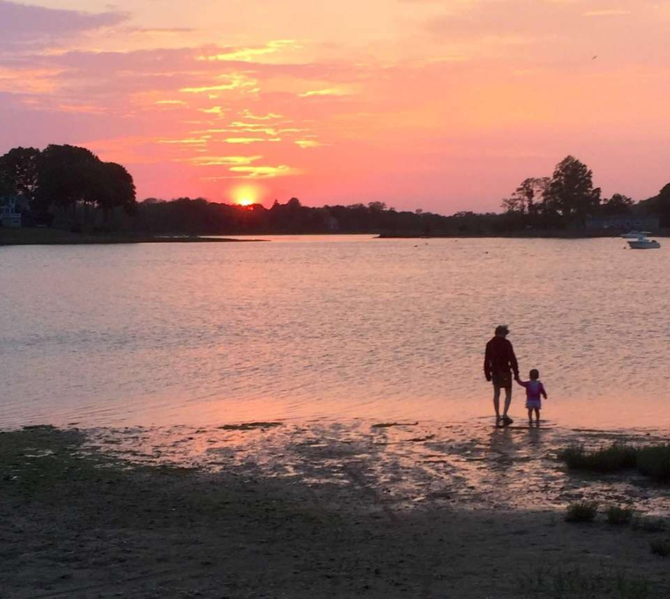 Mother and child looking at sunset at Setauket