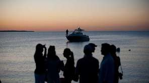Young people flock to Montauk in the summer.